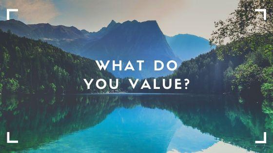 "Mountain lake scene. Text says ""What Do You Value?"""